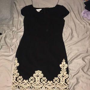 Black lined dress with Beige design